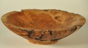 Spalted, worm-eaten cherry bowl with partial natural edge