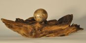 Spalted maple sphere on locust branch